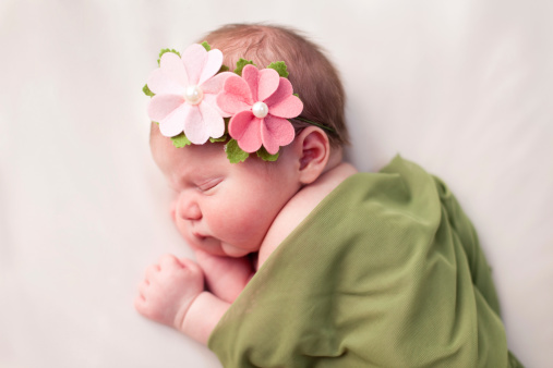 Newborn Baby Girl Swaddled In Soft Green Blanket Stock Photo - Download Image Now