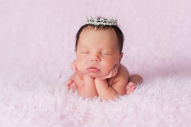 Newborn Baby Girl Wearing a Dainty Rhinestone Crown stock photo