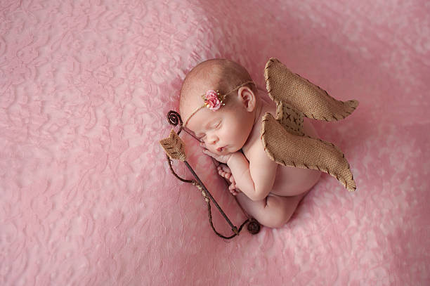 Newborn Baby Girl Wearing Cupid Wings stock photo