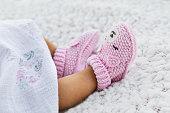 istock Newborn baby girl wearing knitted crochet against a white blanket 1216025711