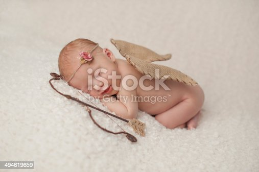 istock Newborn Baby Girl with Cupid Wings and Archery Set 494619659