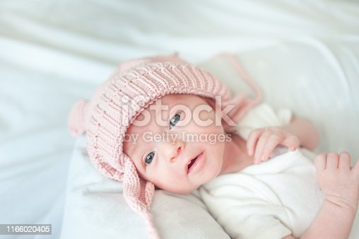 177414958istockphoto Newborn baby girl with hat 1166020405
