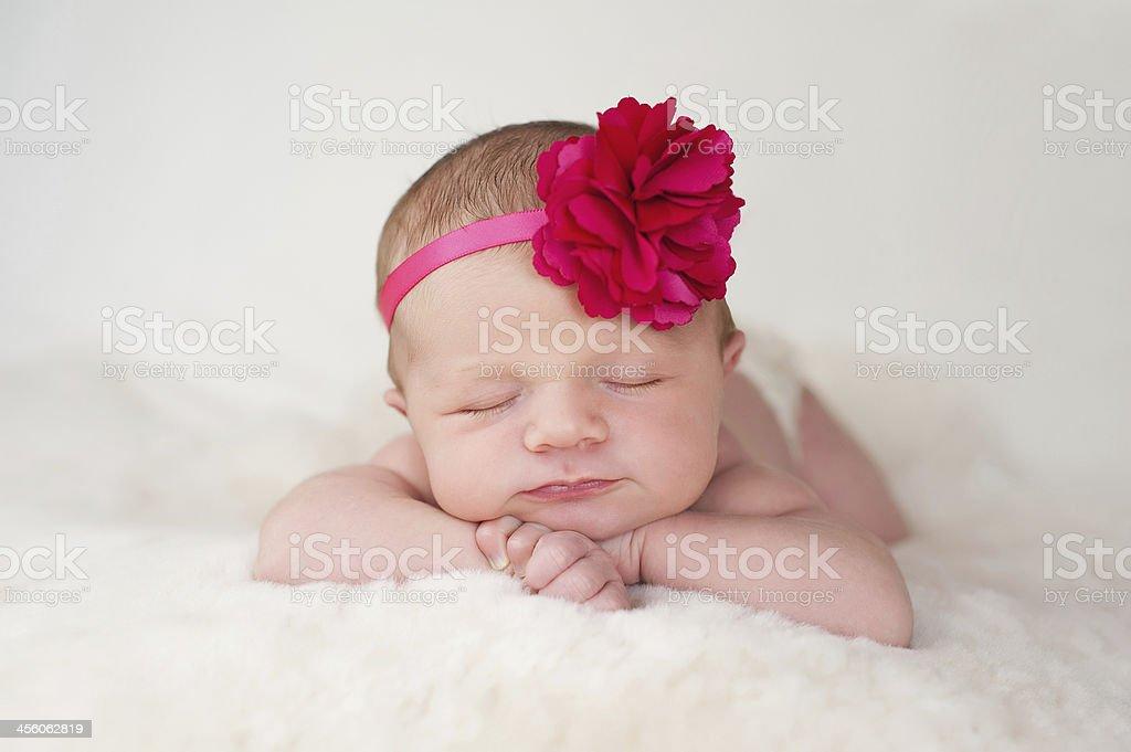 Newborn baby girl with hot pink flower headband stock photo