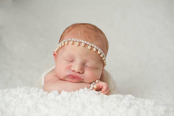 Newborn Baby Girl with Rhinestone and Pearl Headband stock photo