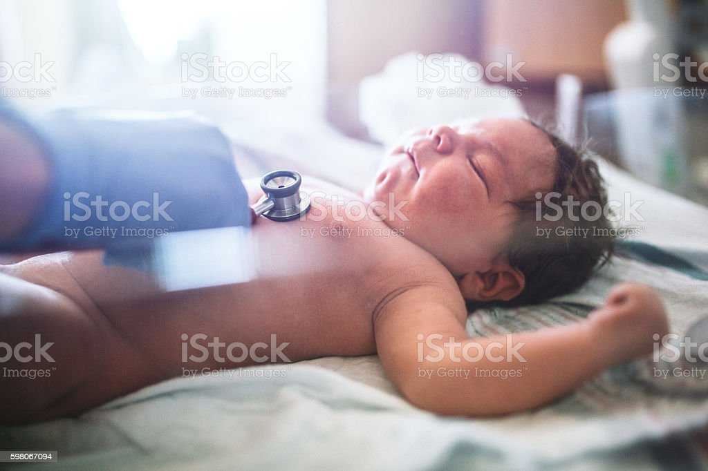 Newborn Baby Having Heart Checked stock photo