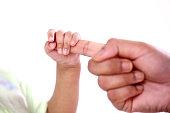 istock Newborn baby holding mother finger 952754284