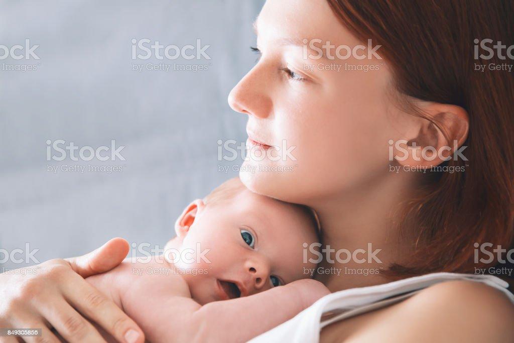 Newborn baby in hands of his mother. stock photo