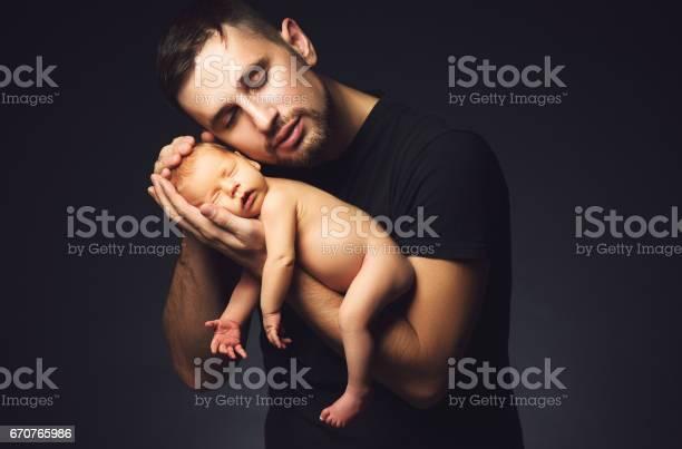 Newborn baby in his fathers hands in dark picture id670765986?b=1&k=6&m=670765986&s=612x612&h=0 r2gzjkt5dg7fbdusuqr3arx3ilaoaaca5zt46d4fe=
