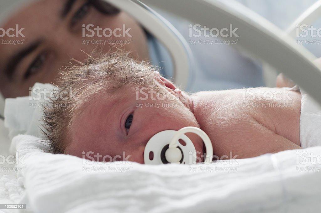 Newborn baby in incubator royalty-free stock photo