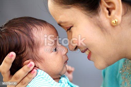 587876546istockphoto Newborn baby on hands mother 952754130