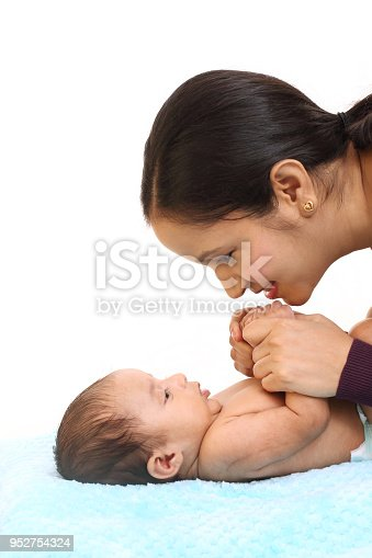 587876546istockphoto Newborn baby on hands mother 952754324