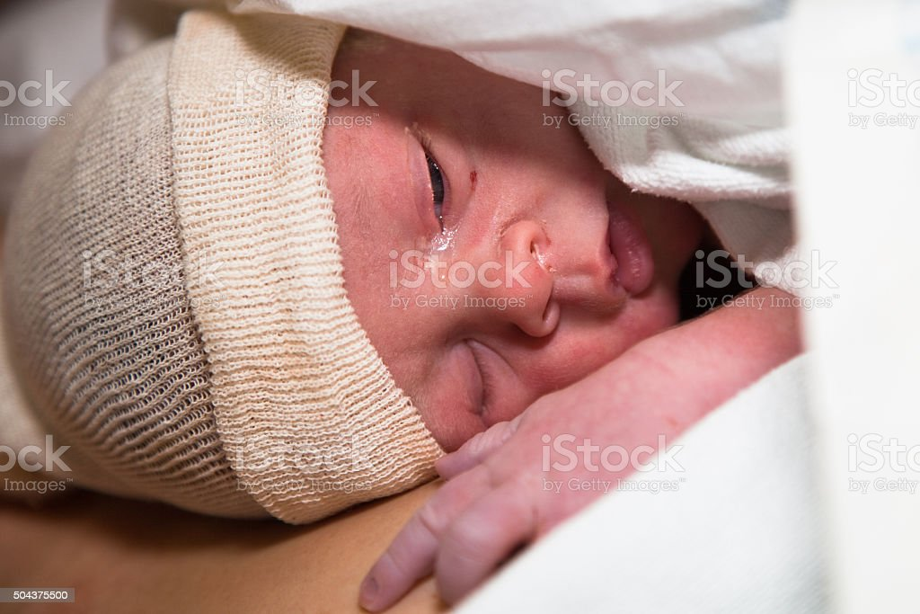 Newborn baby one hour after delivery stock photo
