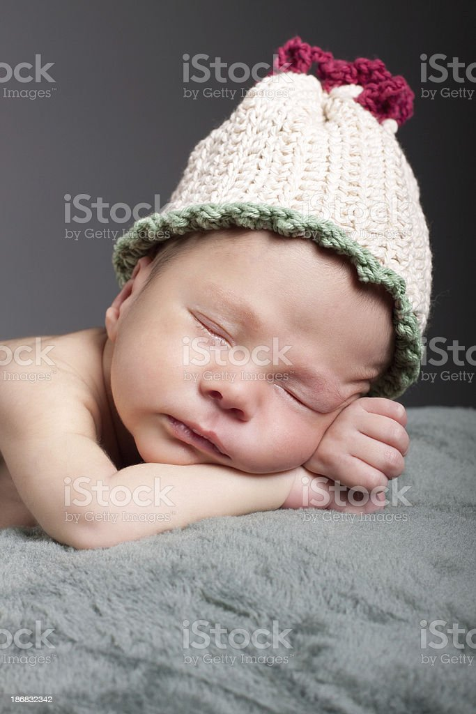 Newborn Baby Sleeping And Wearing Hat Stock Photo   More Pictures of ... c03b61fb6eaf
