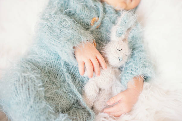 Newborn baby sleeping baby in bed holding a bunny toy baby with blue picture id1185006897?b=1&k=6&m=1185006897&s=612x612&w=0&h=2c3toxupsutdd6oqcz5pzgtjj g xft5ptoiz9efmng=