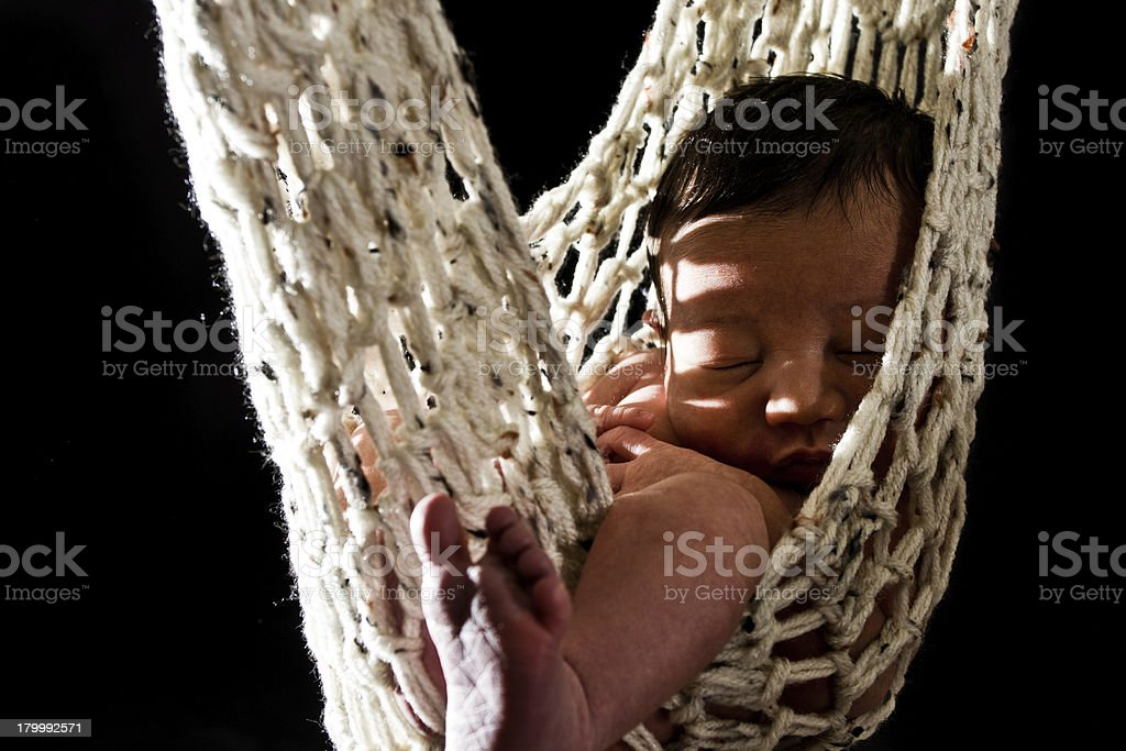 Newborn Baby Sleeping In A Hammock Hanging From Tree Stock Photo