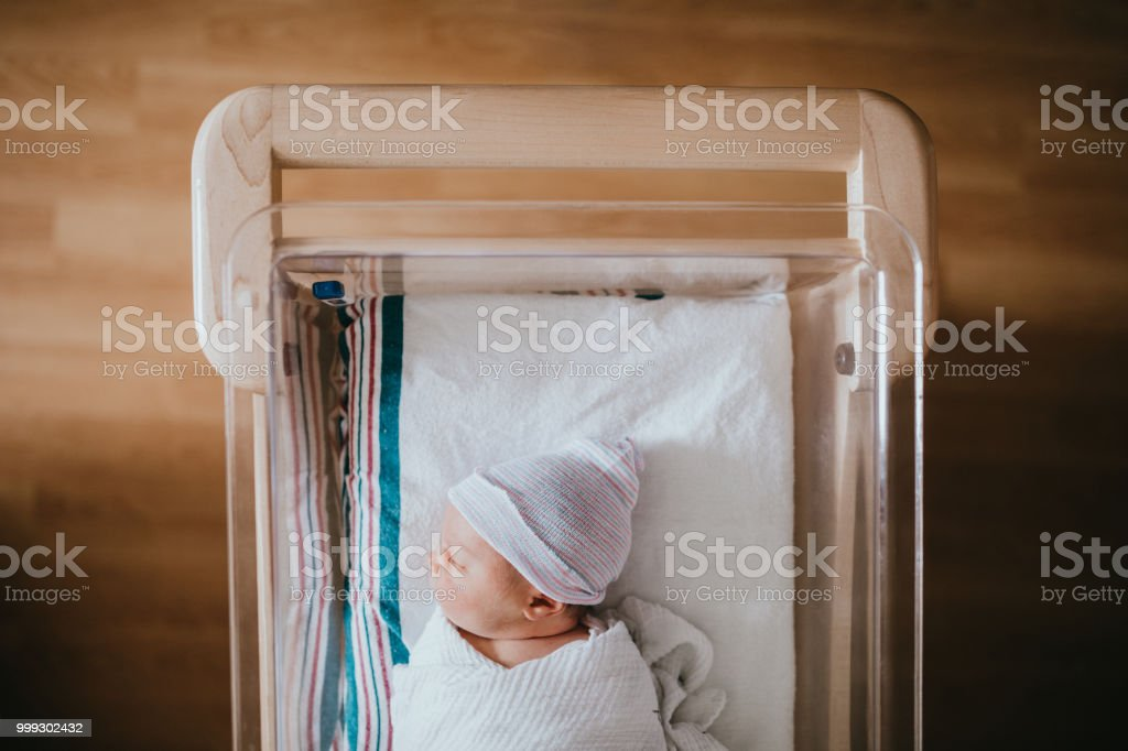 Newborn Baby Sleeping In Hospital Bassinet stock photo