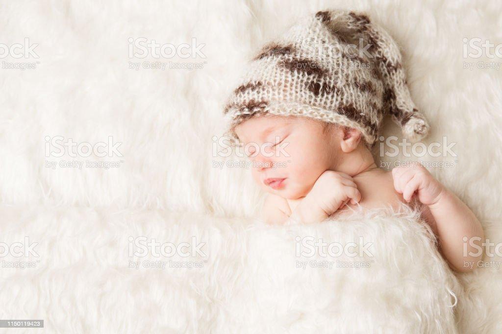 Newborn, baby sleeping in white bed, beautiful new born infant...