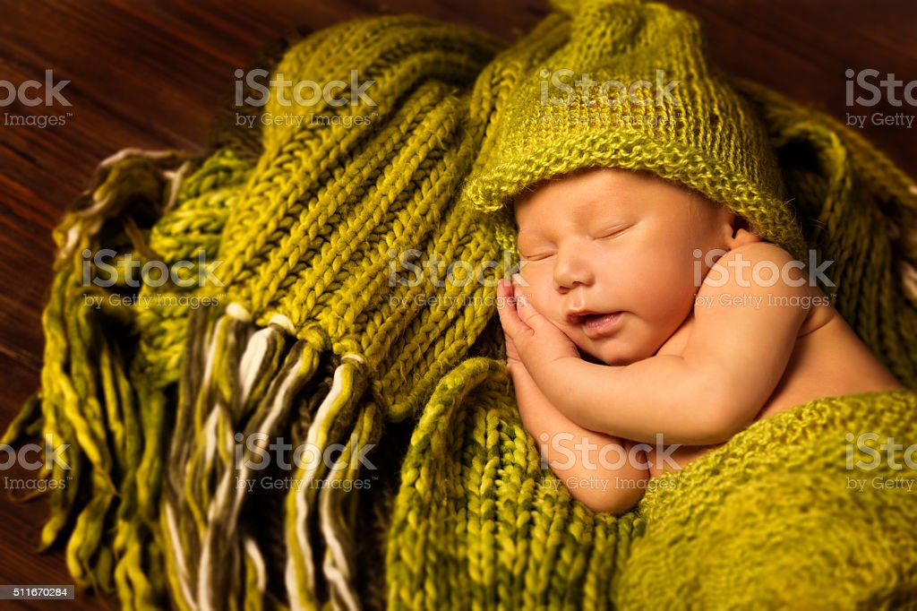 Newborn Baby Sleeping, New Born Kid Sleep, Green Woolen stock photo