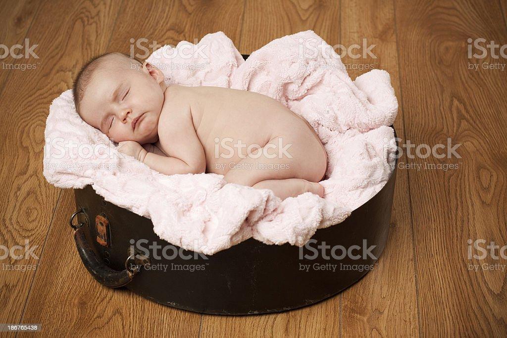 Newborn Baby Sleeping on Pink Blanket Wood Floor Background royalty-free stock photo