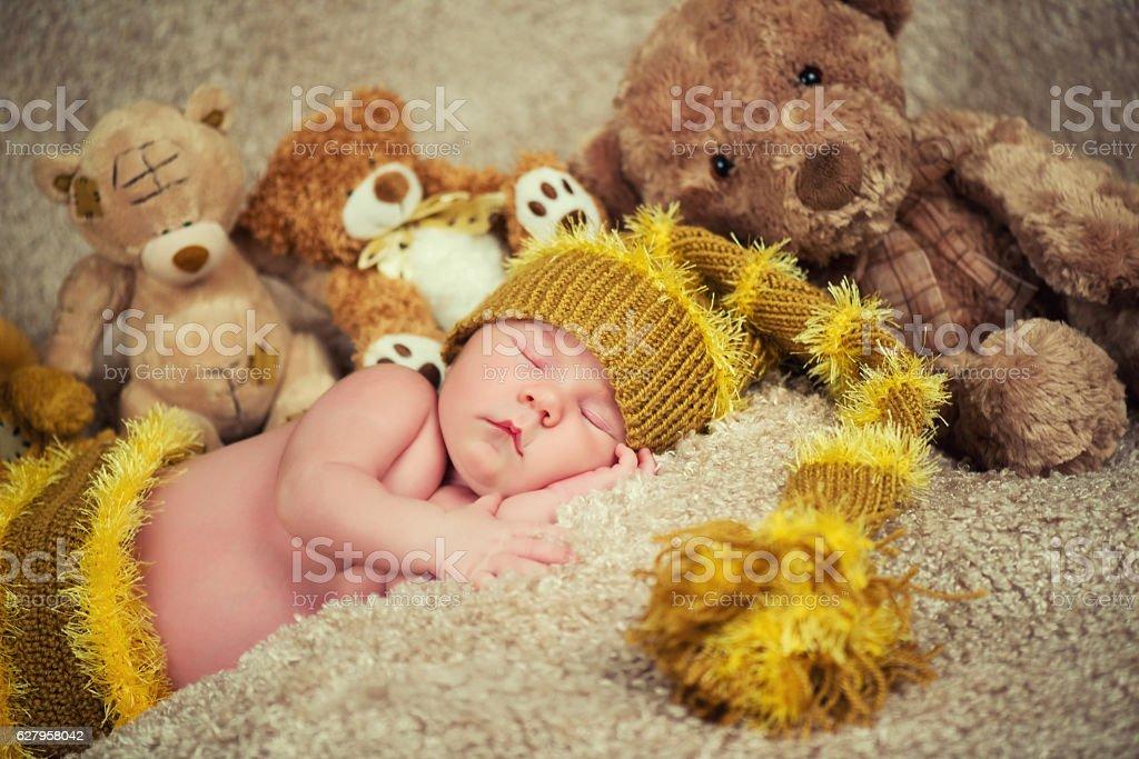 Newborn baby sleeping on toys background. стоковое фото