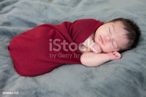 Newborn baby sleeping outside.