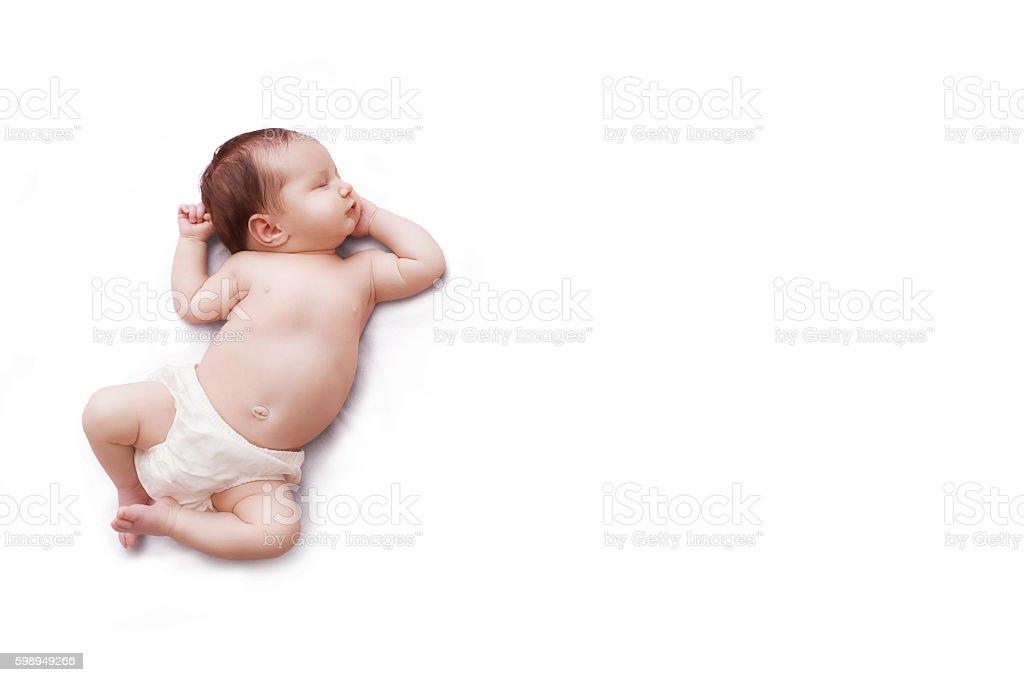 Newborn baby sleeps on white background stock photo