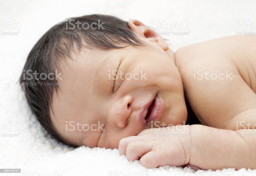 Newborn baby smiling in his sleep royalty-free stock photo