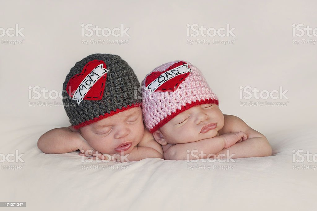 Newborn Baby Twins in Love Mom and Dad Hats stock photo
