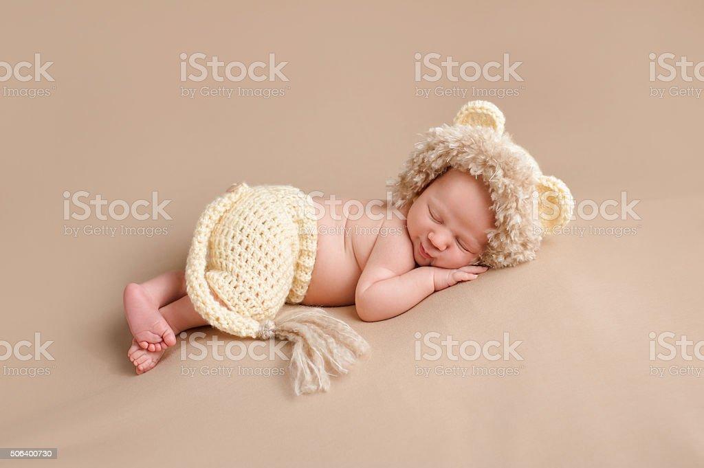 Newborn Baby Wearing a Lion Costume stock photo