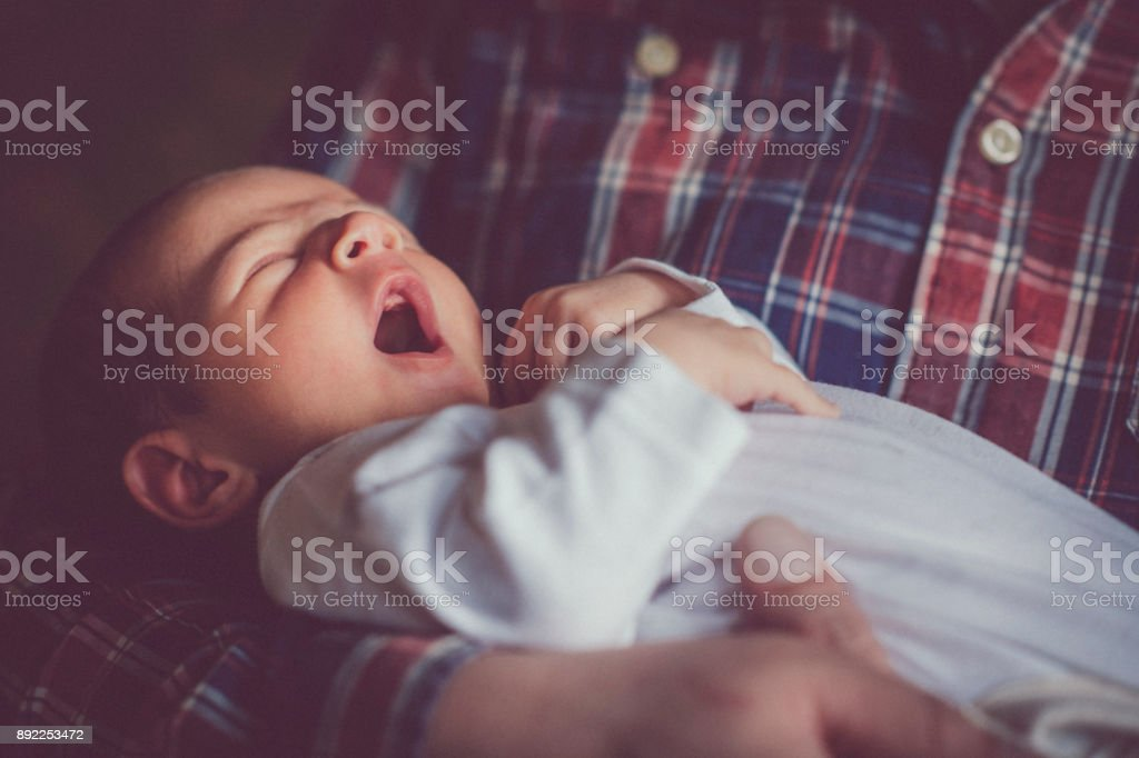 Newborn baby yawning stock photo