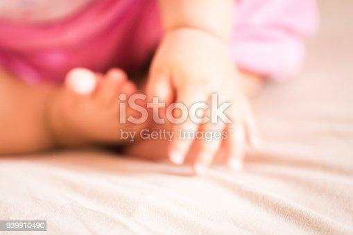 istock Newborn baby's hands and feet defocused backgrounds 939910490