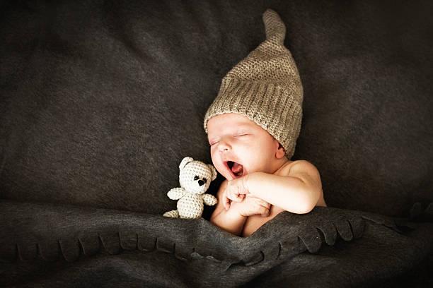 Newborn babysleeping with a toy picture id578797080?b=1&k=6&m=578797080&s=612x612&w=0&h=caauim35i3lfhjcps4tx1cucwrudg2iq9f xftajgrs=