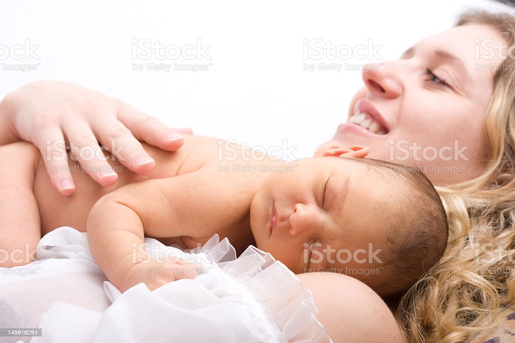 A newborn child sleeping on its mother royalty-free stock photo