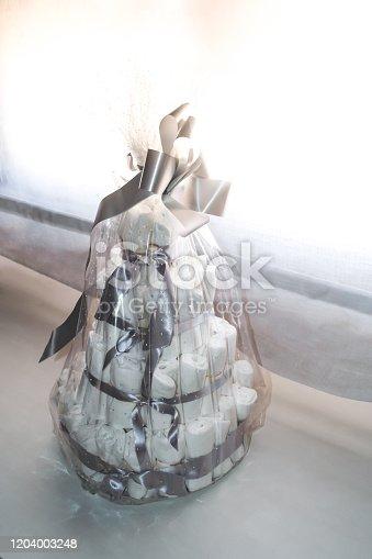 newborn diaper basket, shaped like a cake. gift