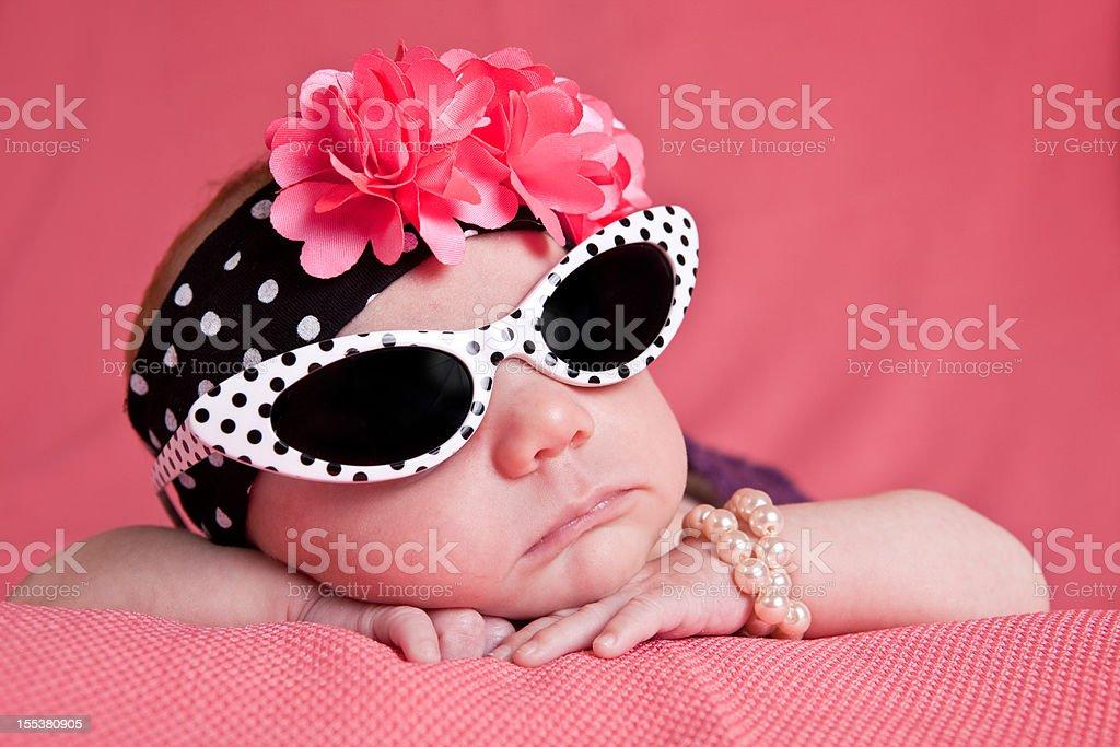 Newborn Girl in Sunglasses stock photo