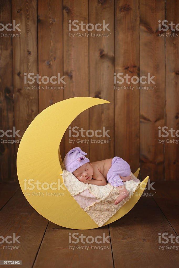 Newborn Girl Sleeping on the Moon - Photo