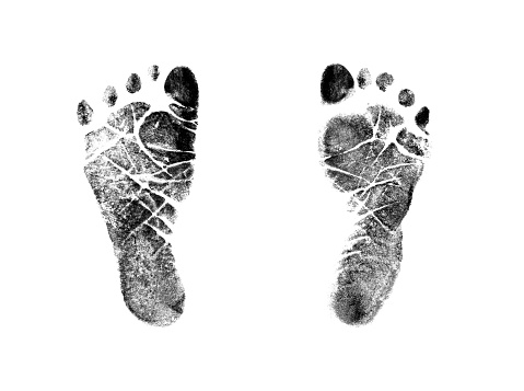 Authentic Inked stamped impressions of a newborns' feet isolated on a 100% white background. Photographed with a Canon 5D.