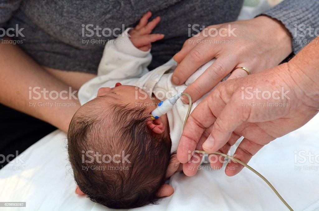 Newborn Infant Hearing Screening stock photo