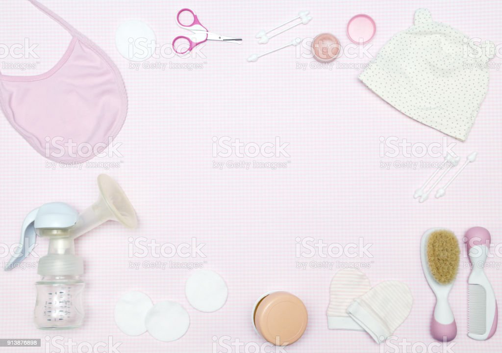 Newborn items on the pink background, knolling style. Top view. Flat lay. stock photo