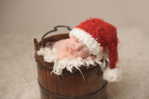 Newborn Sleeping in Antique Bucket