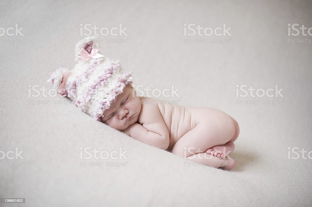 Newborn Sleeping in Knit Hat royalty-free stock photo