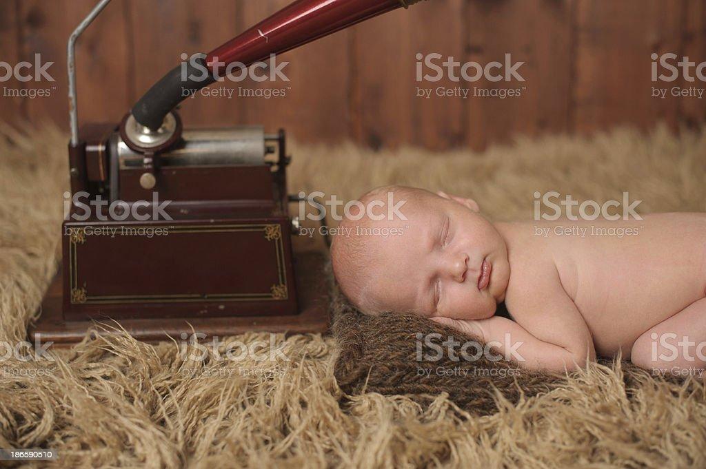Newborn Sleeping Next to Phonograph royalty-free stock photo