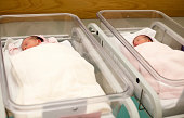 Newborn baby twins in their hospital cot