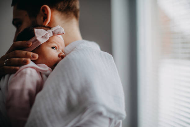 Newborn with Father stock photo