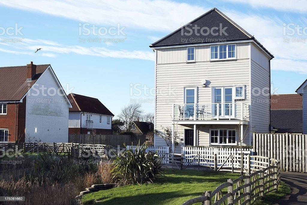 Newbuild timber boarded house on the coast - UK stock photo