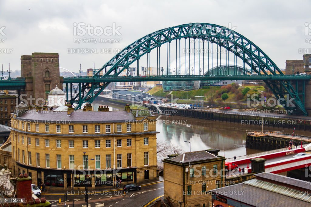 Newcasstle city Skyline with Tyne Bridge in view at Newcastle Quayside on a cloudy day stock photo