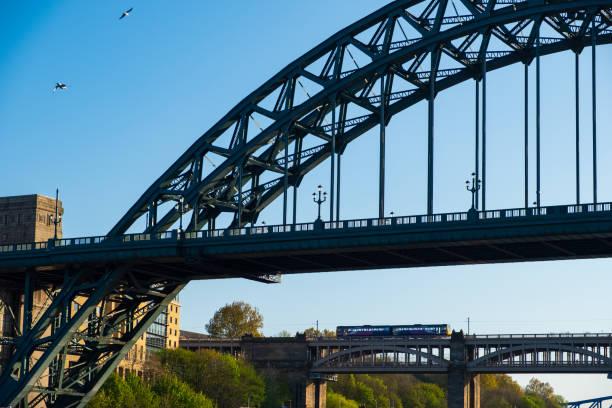 Newcastle Gateshead Quayside with River Tyne and Tyne Bridge in view stock photo