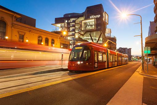 Newly installed light rail in Newcastle CBD Australia. Illuminated at dusk.