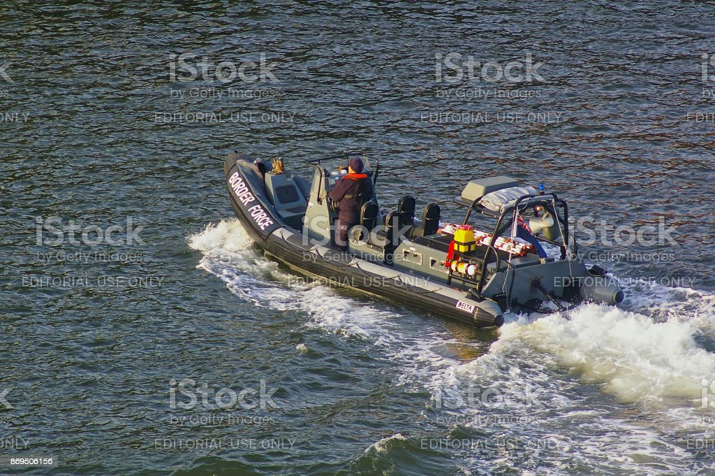 Newcastle, United Kingdom - October 5th, 2014 - UK border force RIB patrol boat with crew member stock photo