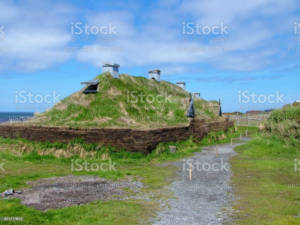 Newfoundland, CA:  L'Anse aux Meadows on June 24, 2011. Re-creation of a Viking timber-and-sod-longhouse.  L'Anse aux Meadows is the first and only known site established by Vikings in North America. stock photo